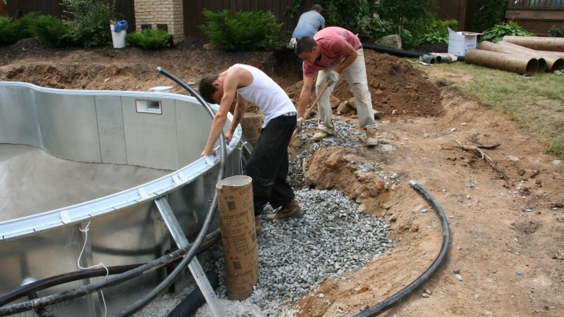 Pool building process - plumbing and backfilling
